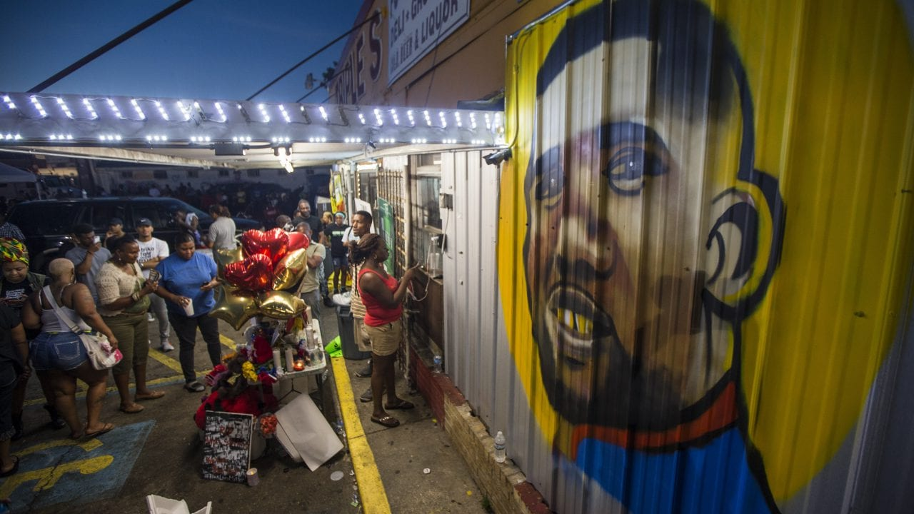 BATON ROUGE, LA -JULY 06:  protesters gather in front of a mural painted on the wall of the convenience store where Alton Sterling was shot and killed, July 6, 2016 in Baton Rouge, Louisianna.  Sterling was shot by a police officer in front of the Triple S Food Mart in Baton Rouge on Tuesday, July 5, leading the Department of Justice to open a civil rights investigation. (Photo by Mark Wallheiser/Getty Images)